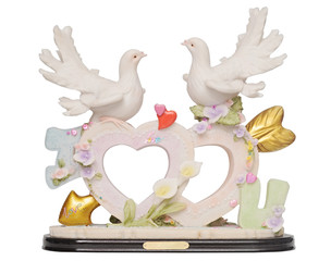 Old romantic statuette  with heart shape and doves isolated on w