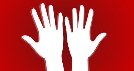 mains en l'air sur fond rouge