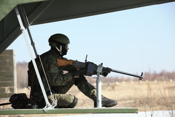 Soldier in helicopter on patrol
