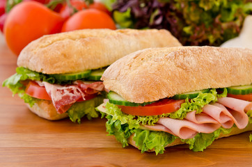 Pair of sandwiches filled with various ingredients