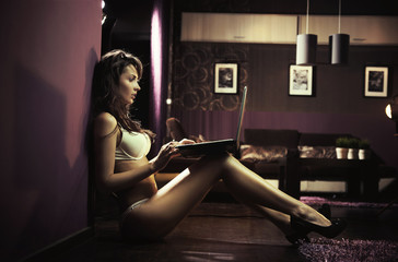 Sexy lady browsing internet late night