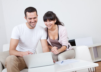 Young couple shopping in internet