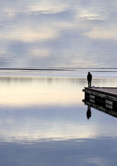 Solitude - man fishing on pier