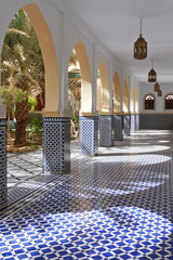 Courtyard with arches and tiles in Moroccan style in Rissani