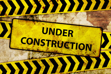 rusty under construction sign