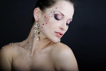 beautiful fashionable girl on dark background with diamond