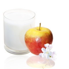 The red apple glass of fresh milk over white background