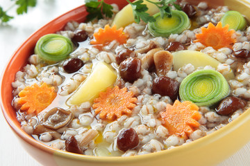 Soup with barley, mushrooms, potatoes, carrots, leek