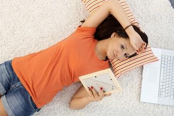 Teenage girl daydreaming at home