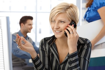 Happy businesswoman on phone call