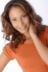 Portrait of beautiful smiling woman in orange