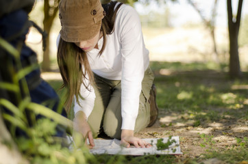 Young woman looking at a map on hiking trip
