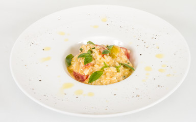 photo of delicious risotto dish with herbs and tomato on white b
