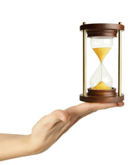 A woman hand holding a hourglass