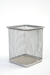 Empty wire metal bin on white background