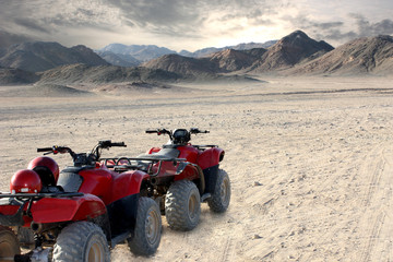 landscape of egyptian desert and all-terrain vehicle