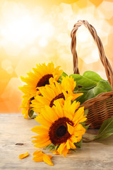 sunflowers on wooden desk