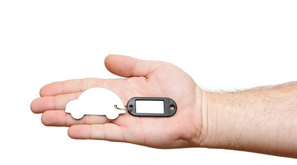 human hands holding model car with blank tag isolated on white b