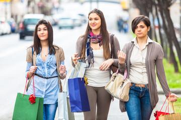 Three Beautiful Young Women doing Shopping