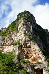 Sandstone rock cliff in Italy, vertical photo