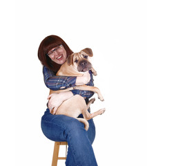 Woman hugging her dog.