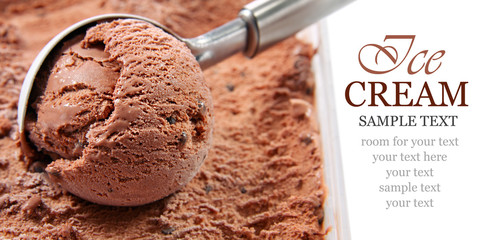 Chocolate ice cream scooped out of a container