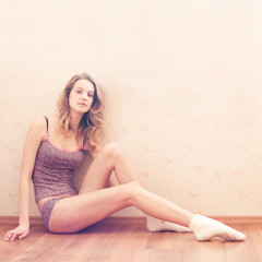 sexy blonde sitting on the floor resting