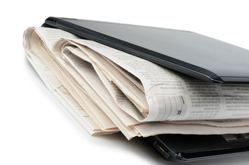 Newspaper and a laptop