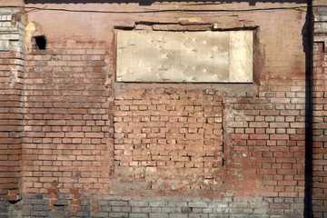 The put window in an ancient brick wall