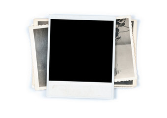 Stack of old photos on white background