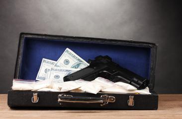 Cocaine, dollars and handgun in case
