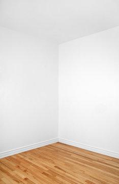 Empty corner of a room with wooden floor
