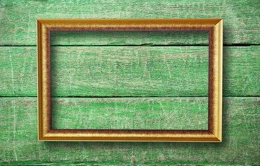 empty frame with copyspace hanging on creative green wooden back