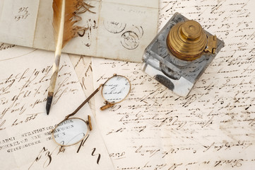ancient letters with feather and eyeglasses