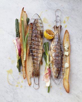 Grilled charr with spring onions, herb butter & toasted bread