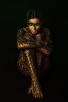 Brunette woman with body art