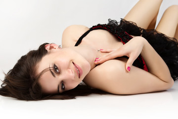 Beautiful young sensual woman lying on the floor.