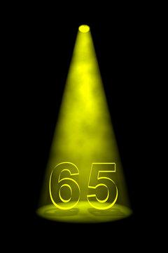 Number 65 illuminated with yellow spotlight