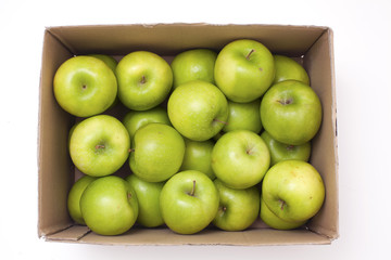 box with green apples