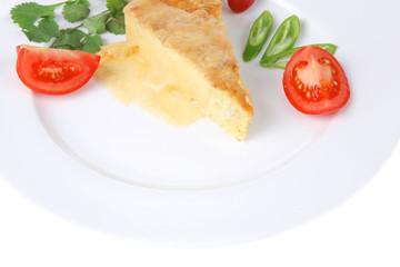 vegetable casserole piece over white plate