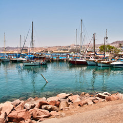 boats on the shore of the Red Sea in Israel