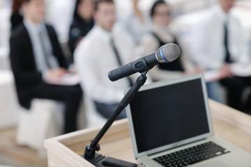 laptop on conference speech podium