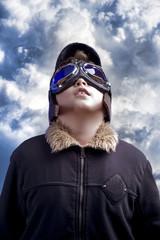 A little boy dreams of becoming a professional pilot. Vintage av