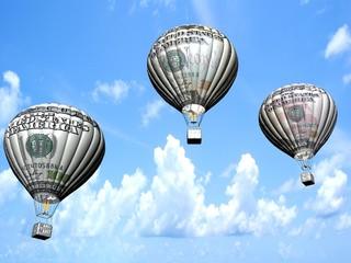 Hot air balloons with 10, 50 and 100 dollar banknotes