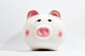 a piggy saving box on white background