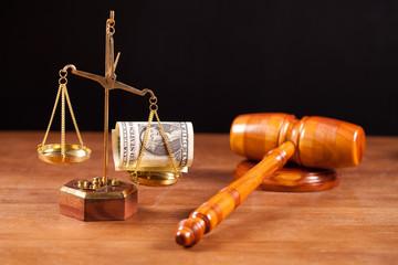 judge gavel and balance with money