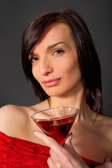 Young woman with wine in glass.