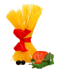 Raw pasta with red ribbon and tomato