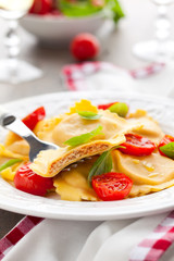 Ravioli with tomatoes and basil