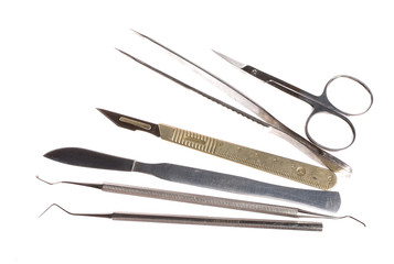 scalpel and other medical instruments isolated on white, no shad